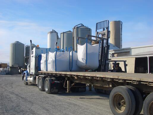 Bulk bags being loaded by forklift for transport via truck