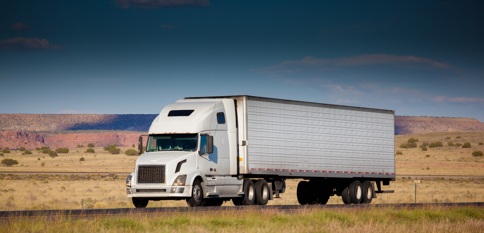 Freight carrier transporting product in Alberta