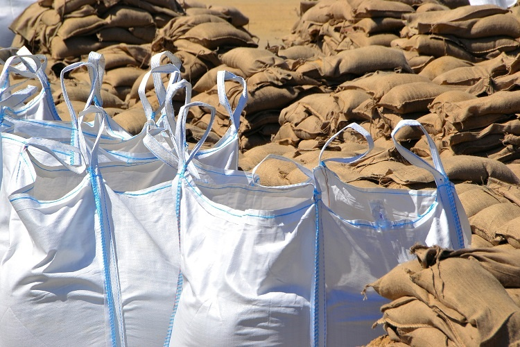 Bulk bags and PP woven bags together for a dam wall.
